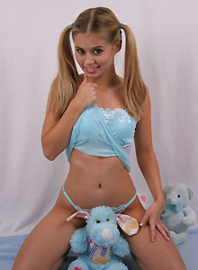 Teen With Pigtails Squeezes Her Perky Tits Together - Picture 3