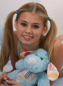 Teen With Pigtails Squeezes Her Perky Tits Together - Picture 6